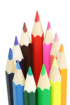 Assortment of multi colored pencils on white background photo