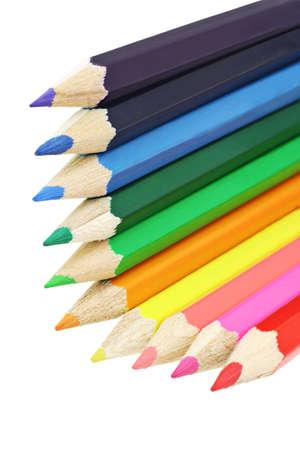 Assortment of color pencils arranged in L shape photo
