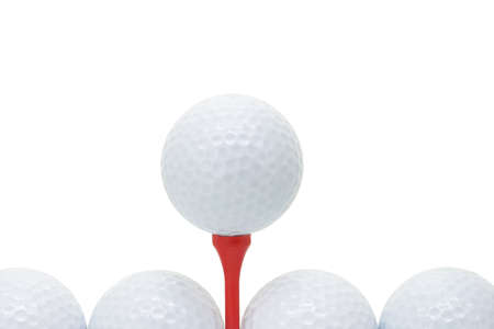 Golf balls with red tee on white background with copy space photo