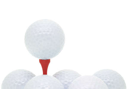 Golf balls and tee arranged on white background with copy space photo