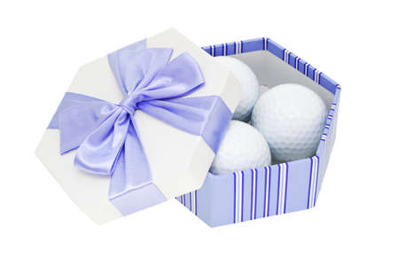 Golf balls in gift box on white background