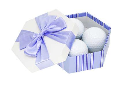 Golf balls in gift box on white background