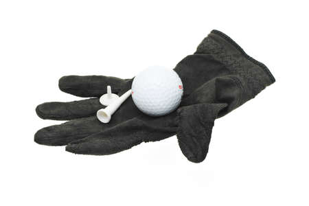 golf glove: Golf ball, tee and marker on a piece of used and worn black glove