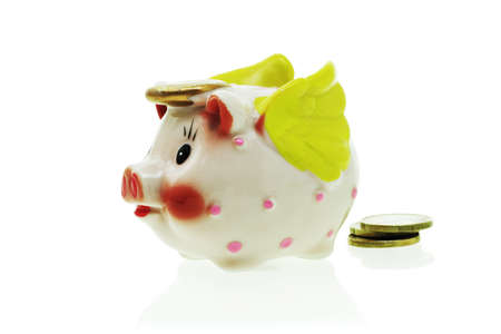 Flying piggy bank and coins on white background Stock Photo - 10388309