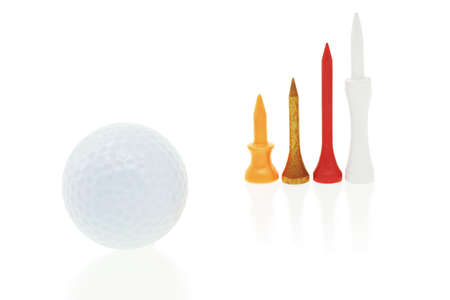 Golf ball and tees of different sizes on white background photo