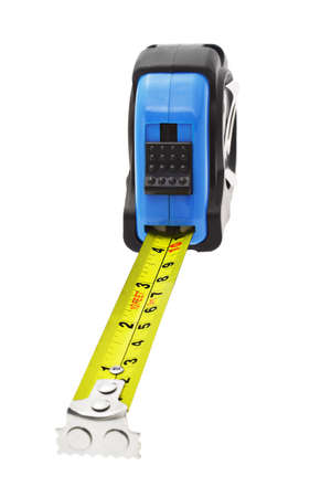 measure tape: Close up of extended measuring tape with magnetic head in metric and imperial units Stock Photo