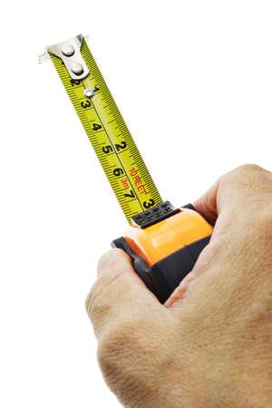 metro de medir: Cartera de mano midiendo cinta sobre fondo blanco