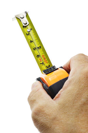 Hand holding measuring tape on white background Stock Photo