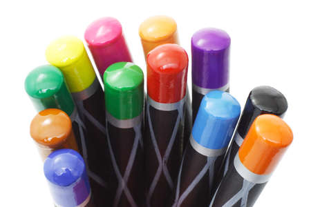 close up of top ends of color pencils on white background photo