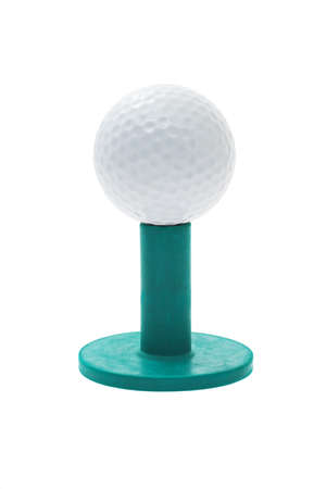 Golf ball on green rubber tee isolated on white background photo