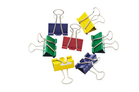 Colorful crocodile paper clips arranged on white background photo