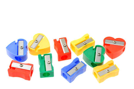 sharpener: Colorful pencil sharpeners arranged on white background with copy space