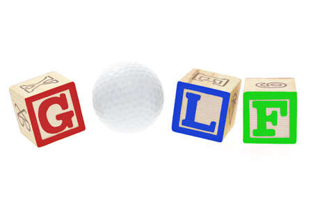 Golf ball and alphabet blocks on white background Stock Photo - 10388497