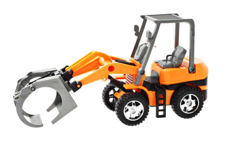 attachments: Toy model of grapple loader tractor on white background