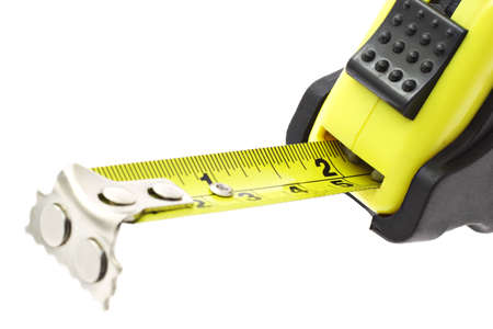 Close up of extended measuring tape with magnetic head in metric and imperial units Stock Photo