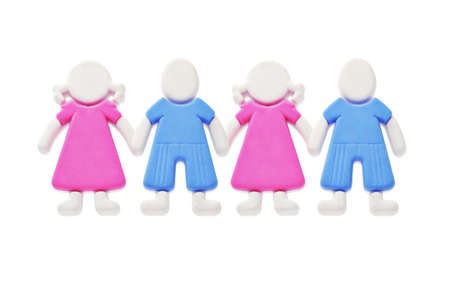 A chain of rubber figurines of boys and girls isolated on white background