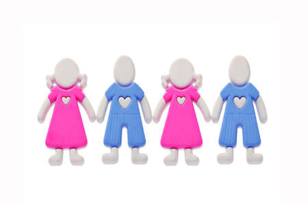coercive: Rubber figurines of boys and girls with love heart symbols on the chest