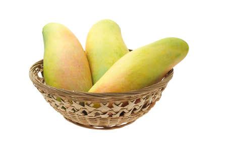 Mangoes in basket isolated on white background photo