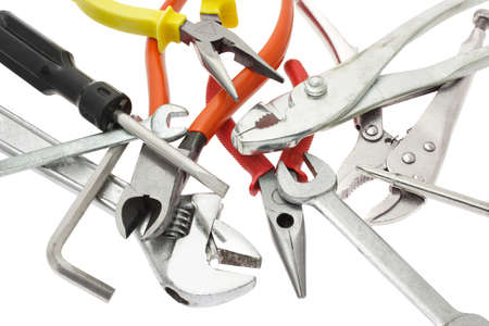 toolkit: Assortment of do it yourself tools placed randomly on white background
