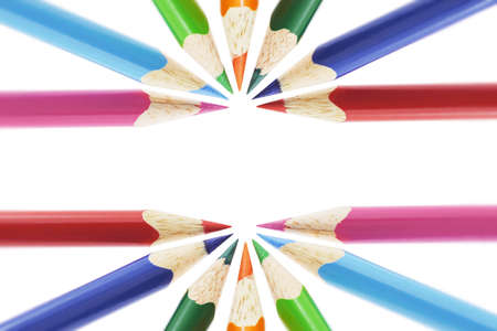 Color pencils arranged on white background with copy space photo