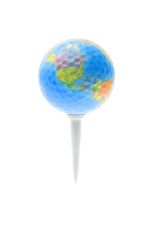Globe with jigsaw puzzle and dimples texture on golf tee isolated on white photo