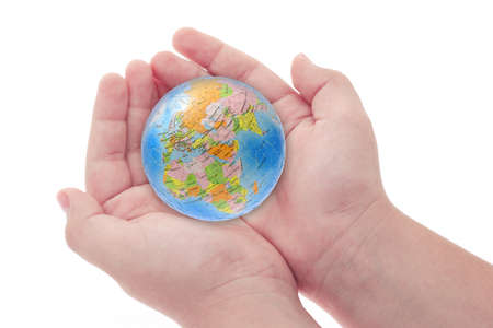 Childs hands holding jigsaw puzzle globe on white background
