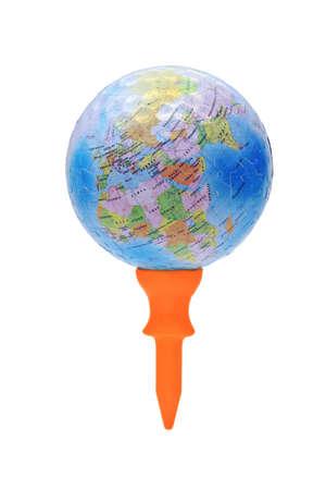 Globe in dimple texture on short orange golf tee  photo
