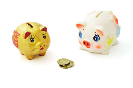 possession: Competition between two piggy banks over possession of coins