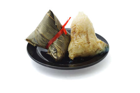 shrimp boat: Wrapped and unwrapped Chinese rice dumplings on plate