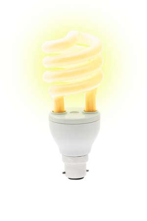 Glowing energy saving light bulb on white background photo