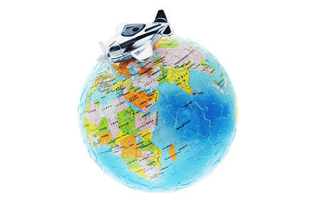 Miniature toy aircraft on top of globe photo