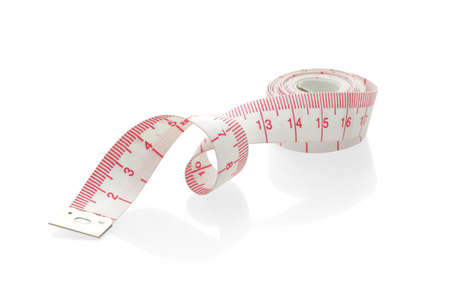 Measuring tape in metric unit on white background Stock Photo