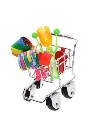 novelties: Party novelties in mini shopping cart on white background
