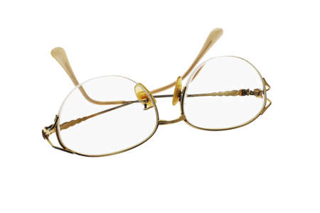 Metal frame feminine eye glasses on white background Stock Photo