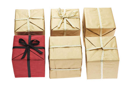 Red color gift box alone among brown boxes on white background photo