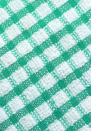 Green and white checkered pattern texture of table cloth for background photo