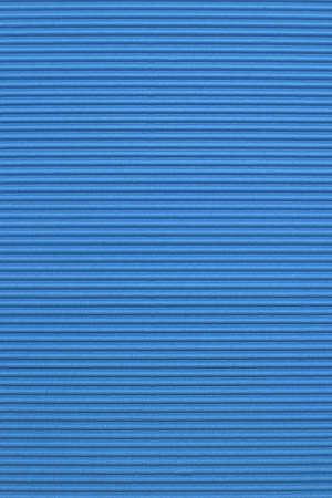 Blue corrugated color paper background photo