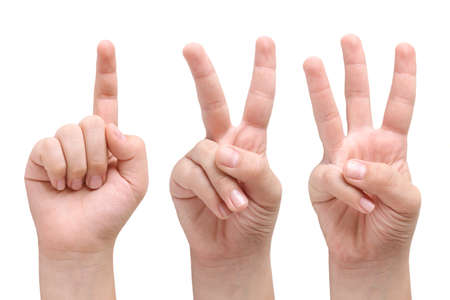 number three: Child hands showing one, two and three fingers Stock Photo