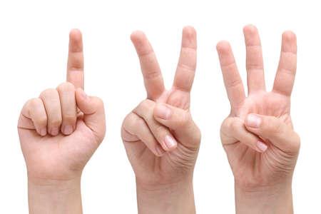 trois enfants: Enfant montrant un, deux et trois doigts des mains Banque d'images