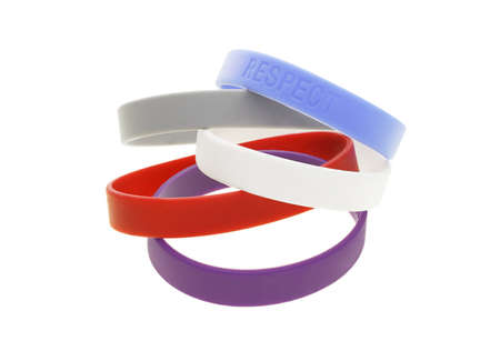 A stack of color wrist bands on white background photo