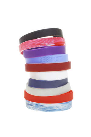 Stack of colorful wrist bands on white background photo
