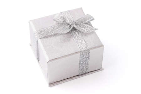 Silver jewelry box decorated with bow ribbon on white photo
