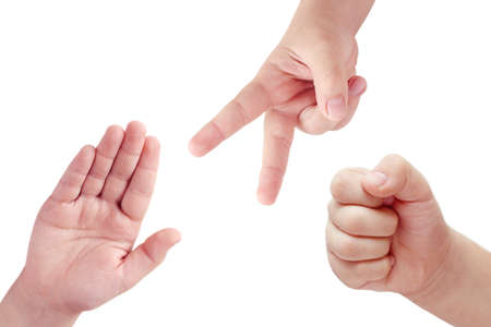 closed fist sign: Children hands playing rock, paper and scissors game