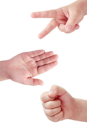 closed fist sign: Childrens hands playing rock, paper and scissors game