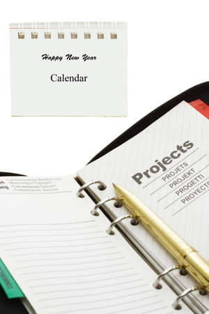 ring binder: New year calendar, orgainzer and pen on white background Stock Photo