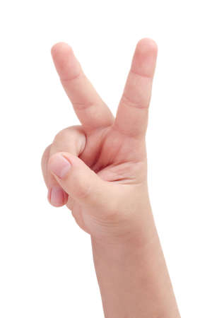 Childs hand displaying peace sign on white background photo
