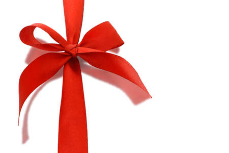 reflective background: Red decorative bow ribbon with relection on white background