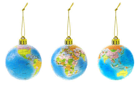 Three Christmas globe ornaments showing different continents photo