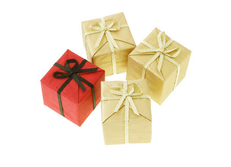 Red gift box among gold color boxes photo