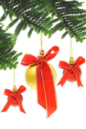 suspend: Christmas baubles with red bow ribbon on white background Stock Photo
